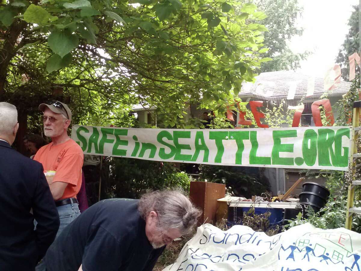Supporters of SAFE (Standing Against Foreclosure and Eviction) rally Thursday afternoon to protest the eviction of Jeremy Griffin, who fell behind on mortgage payments after a period of being in and out of work in recent years. Sheriff's deputies cleared the South Park property and arrested four people who refused to leave.