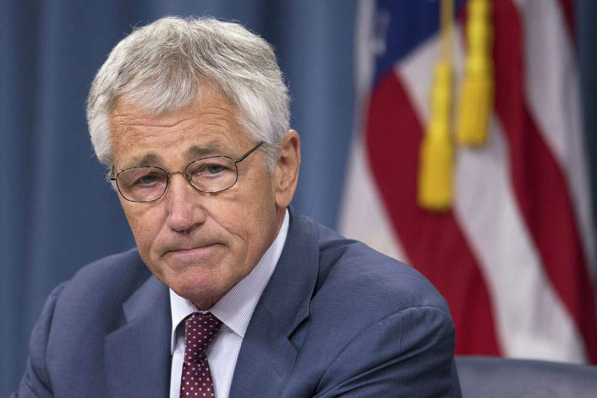 Defense Secretary Chuck Hagel pauses during a news conference at the Pentagon, Wednesday, July 31, 2013. Hagel warned that the Pentagon may have to mothball up to three Navy aircraft carriers and order more sharp reductions in the size of the Army and Marine Corps if Congress does not act to avoid massive budget cuts beginning in 2014.