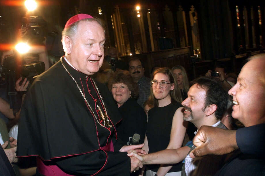 Archbishop-designate Edward Egan greets worshipers at St. Patrick's Cathedral in New York Thursday, May 11, 2000, after saying a prayer for the late Cardinal John O'Connor. Egan, 68, an Illinois native, today was named by the Vatican to replace O'Connor and assume the spiritual leadership of 2.4 million followers. Photo: MARK LENNIHAN, Associated Press / AP Photo/Mark Lennihan Associated Press