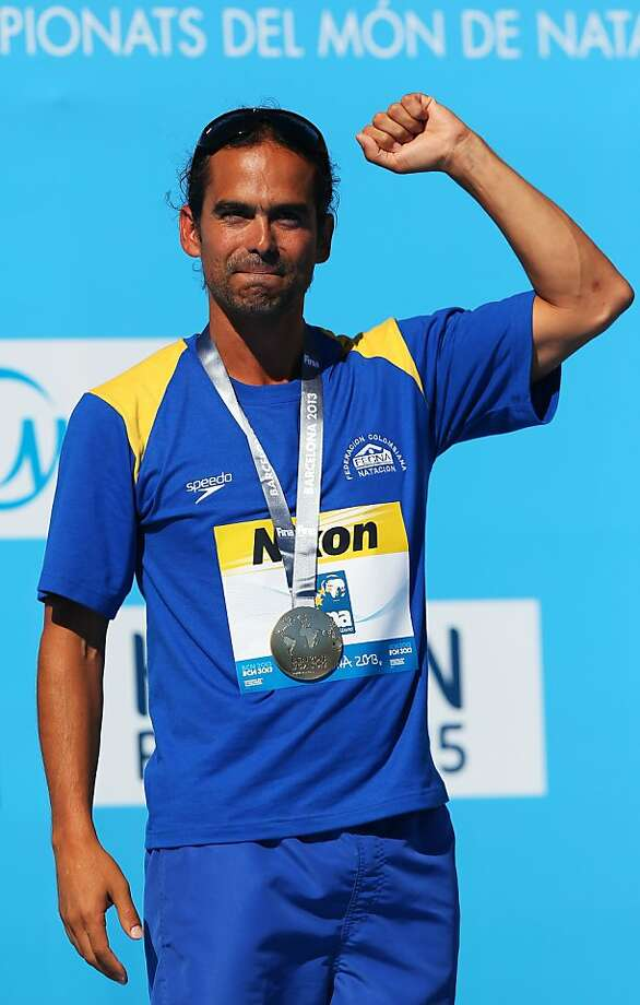 Orlando Duque of Colombia won the gold medal by less than a point. Photo: Clive Rose, Getty Images