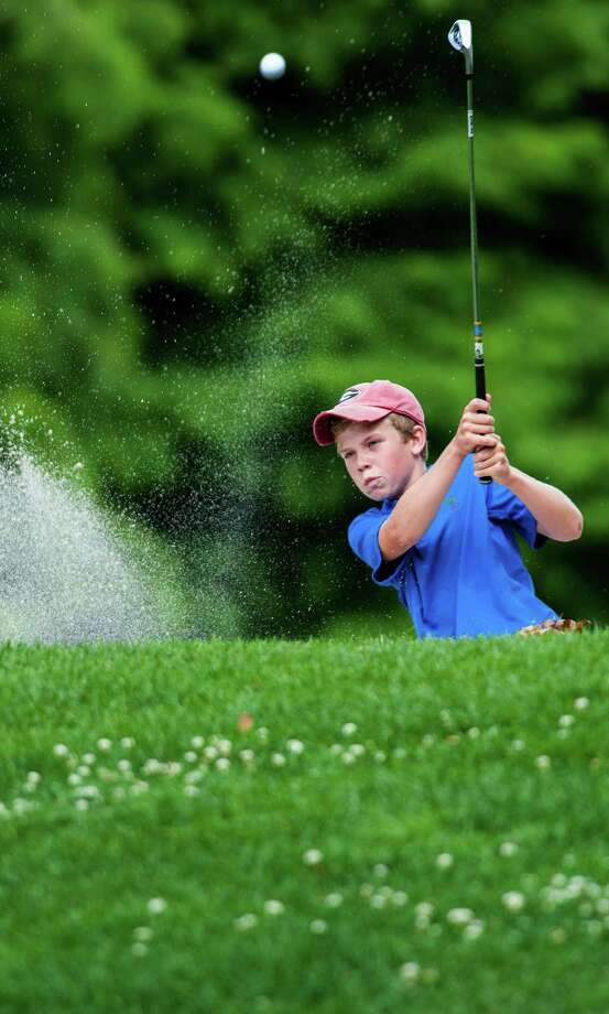 Walker Williams hits out of a sand trap on the 18th hole during the Greenwich Town Junior Golf Championships held at Griffith E. Harris golf course, Greenwich, CT on Wednesday July 31st, 2013. Photo: Mark Conrad / Stamford Advocate Freelance