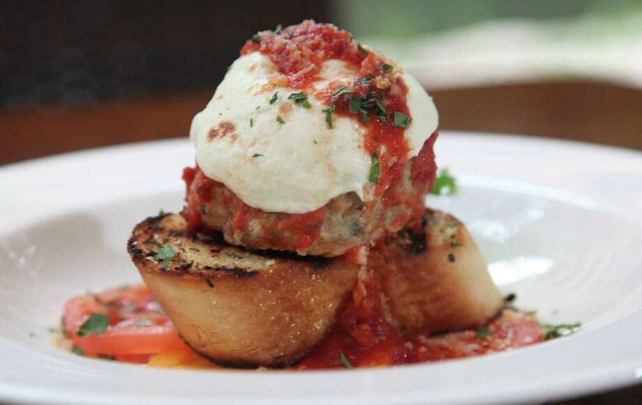 Jumbo meatballs are on the menu at Zocca, a River Walk restaurant. Photo: Juanito M. Garza / San Antonio Express-News