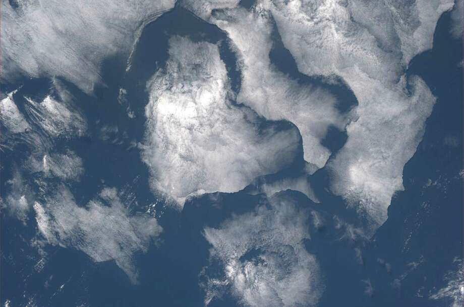 """Cloud gazing over the Pacific Ocean. Hearts?"" Karen Nyberg, July 25, 2013.  Photo: Karen Nyberg, International Space Station"