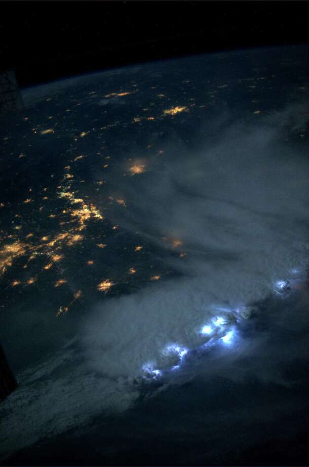 An impressive line of storms moving through Asia on July 24, 2013. The lightning was amazing - the most I've seen in a single accumulation of storms. KN from space. Photo: Karen Nyberg, International Space Station