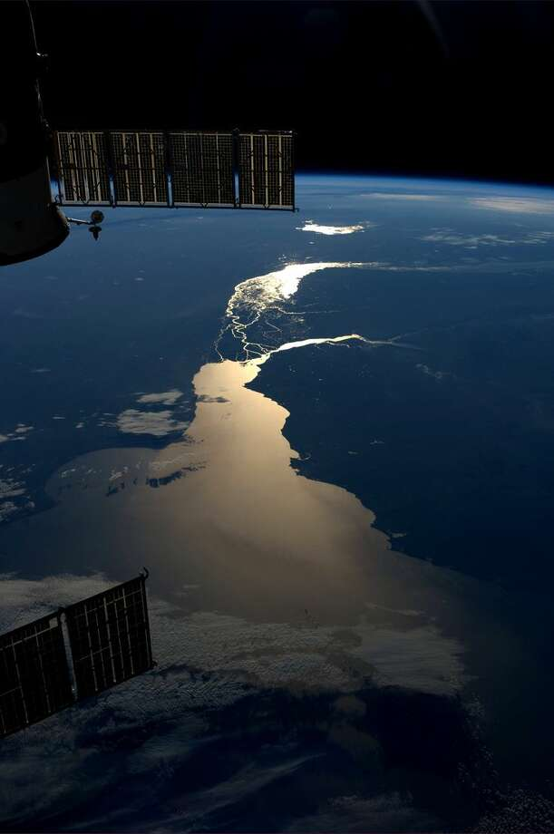 Sunset over the Rio de la Plata in South America. Taken July 15, 2013. KN from space. Photo: Karen Nyberg, International Space Station