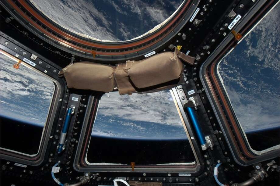 """Our windows to the world, the cupola"" - Karen Nyberg, July 2013. Photo: Karen Nyberg, International Space Station"