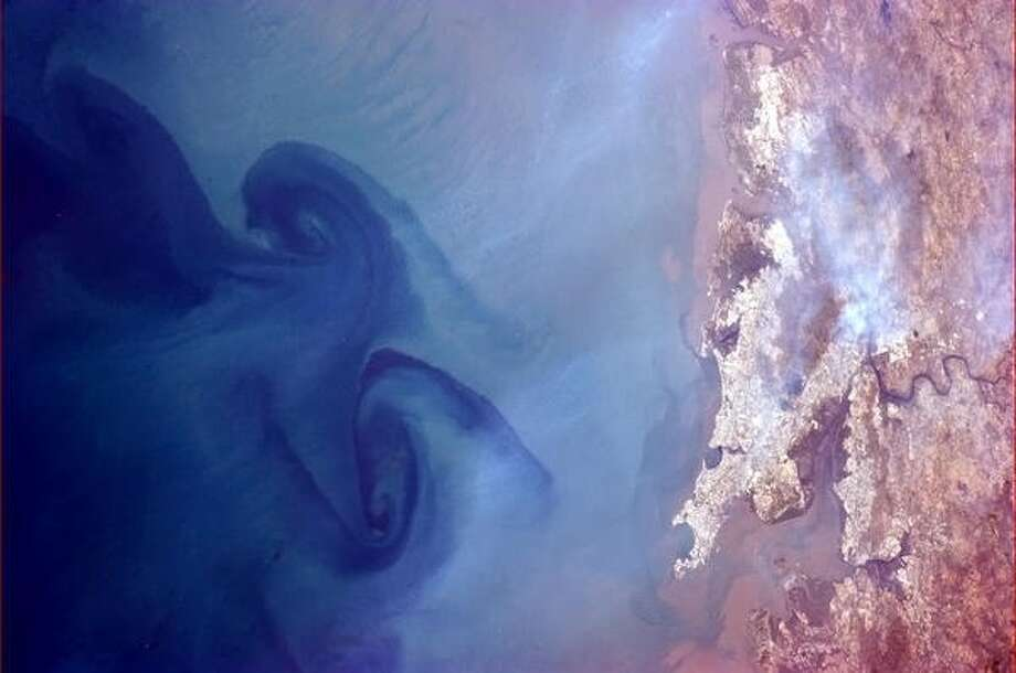 """Huge swirls in the sea off of Mumbai, India"" - Chris Hadfield, 2013.  Photo: Chris Hadfield, Internationship Space Station"