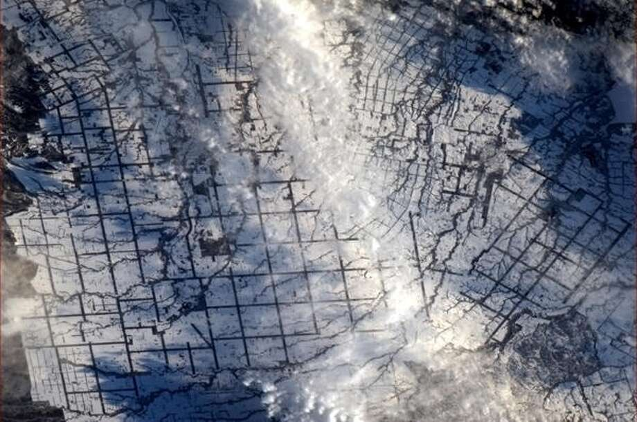 """Japanese rice fields tidily blanketed with snow""- Chris Hadfield, 2013.  Photo: Chris Hadfield, Internationship Space Station"