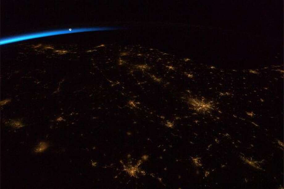 """The Moon ushering in the dawn over the Southeastern United States"" - Chris Hadfield, 2013.  Photo: Chris Hadfield, Internationship Space Station"