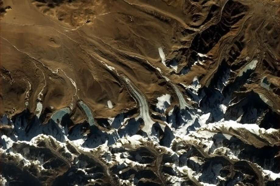 """Glacier tongues in the Himalayas."" - Chris Hadfield, 2013.  Photo: Chris Hadfield, Internationship Space Station"
