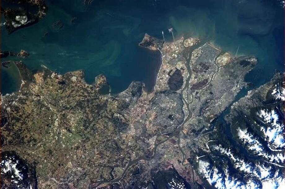 """A clearer view of Vancouver on a sunny day - can clearly see the ferry terminal, airport and many boats in the Inlet."" - Chris Hadfield, 2013.  Photo: Chris Hadfield, Internationship Space Station"