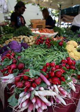 Radishes are displayed by a vendor at the Heart of the City farmers market at UN Plaza in San Francisco, Calif., on Wednesday, July 8, 2009. Vendors at the civic center market have long been accepting food stamp tokens from customers. A plan proposed by Mayor Newsom will require all farmers markets to do the same citywide.