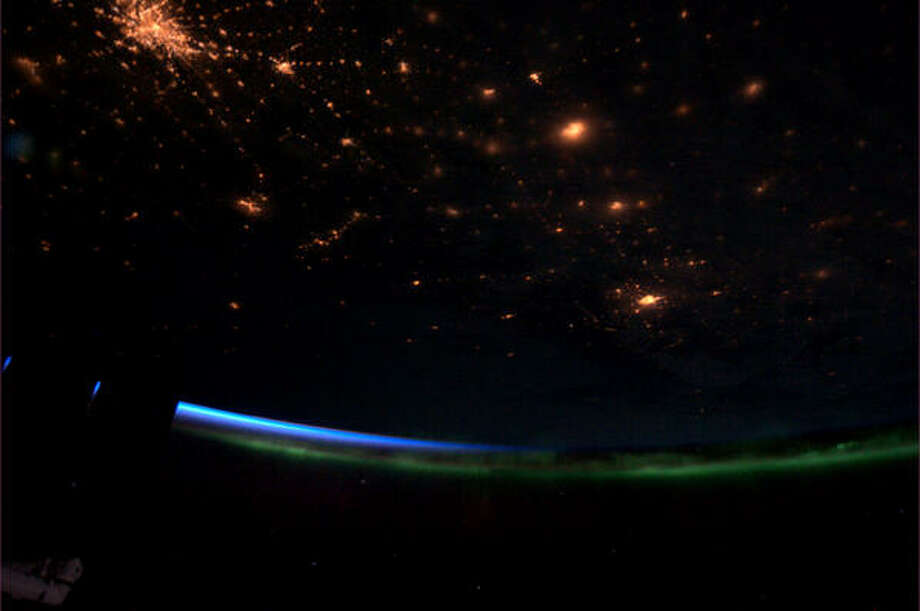 """Tonight's Finale: Dawn sneaking in under the Northern Lights. When we turn our lights down, nature lights up the sky."" - Chris Hadfield, March 2013.  Photo: Chris Hadfield, Internationship Space Station"