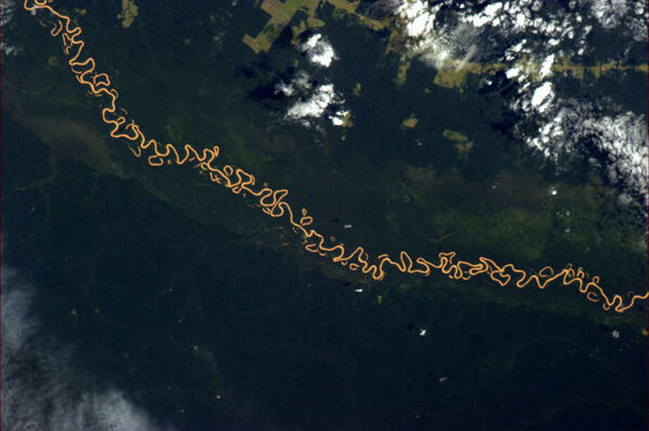 The river hiccups like a zipper on an old coat brazil's Amazon area, April 2013. Photo: Chris Hadfield, Internationship Space Station