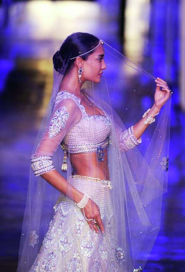 A model  presents a creation by Indian designer Tarun Tahiliani during the Grand Finale of Indian Bridal Fashion Week in New Delhi on July 28, 2013. Photo: SAJJAD HUSSAIN, AFP/Getty Images / 2013 AFP