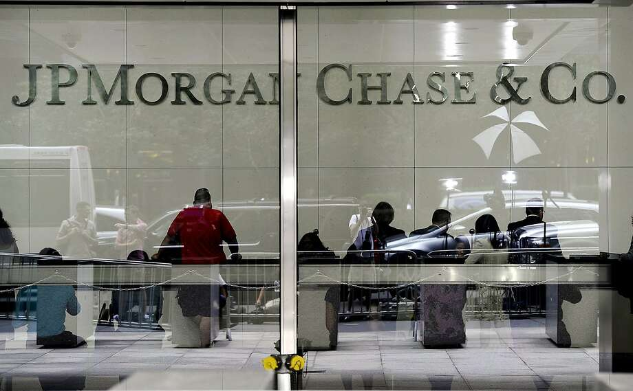 (FILES)Media  are reflected in the glass at the  entrance to the JP Morgan Chase World Headquarters on Park Avenue in this July 13, 2012 file photo in New York. Banking giant JPMorgan Chase agreed to pay a $410 million settlement to resolve US charges that it manipulated power prices in California and the Midwest, the bank and regulators said July 29, 2013. JPMorgan will pay a civil penalty of $285 million to the US Treasury and disgorge $125 million in unjust profits, the Federal Energy Regulatory Commission said in a statement. The bank did not admit or deny the allegations. AFP PHOTO/TIMOTHY A. CLARY / FILESTIMOTHY A. CLARY/AFP/Getty Images Photo: Timothy A. Clary, AFP/Getty Images