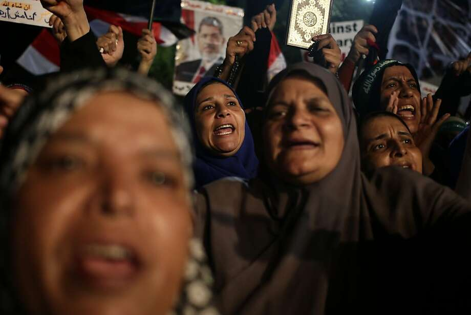Supporters of Egypt's ousted President Mohammed Morsi chant slogans outside the Rabaah al-Adawiya Mosque in eastern Cairo, the larger of the two protest camps in the capital city. Photo: Hassan Ammar, Associated Press