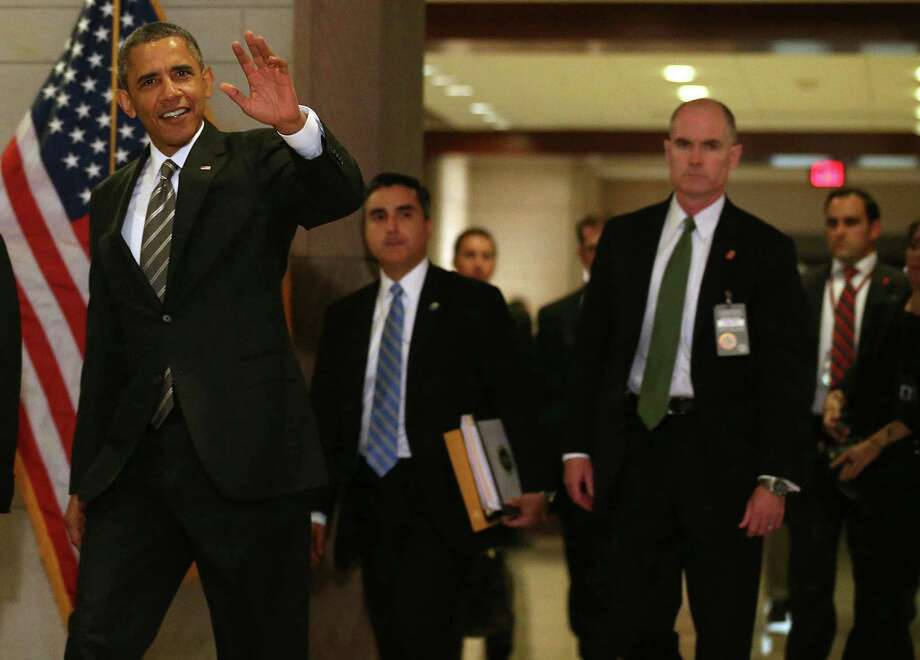 President Barack Obama visited Democrats on Capitol Hill, trying to reassure them before they travel home for the extended summer recess. Photo: Mark Wilson / Getty Images
