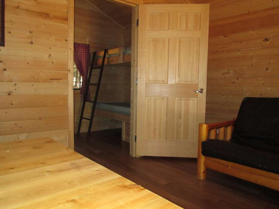 Cabins have gas heat, table, chair and platform beds Photo: Tom Stienstra