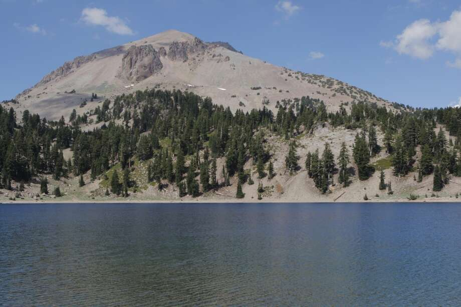 Helen Lake is nestled in a pocket-like cirque at 8,200 feet, at the foot of Lassen Peak Photo: Tom Stienstra