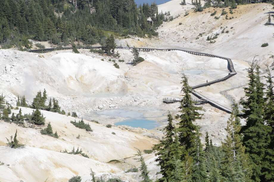 Trail climbs a short ridge to this overlook of the Bumpass Hell geothermal area Photo: Tom Stienstra