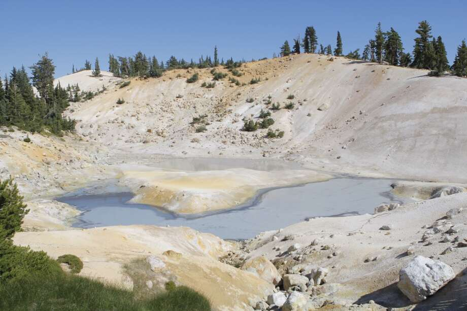Boiling mud pots at far edge of Bumpass Hell Photo: Tom Stienstra