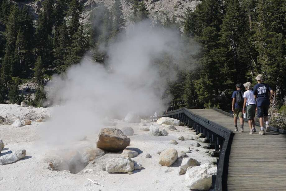 Boy Scouts from Folsom hold their breath as they walk by a steam vent Photo: Tom Stienstra