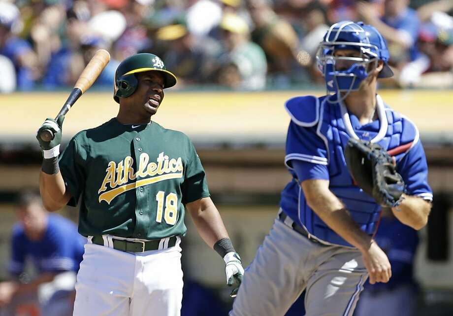 Alberto Callaspo is pained after striking out looking in the ninth inning. He went 0-for-2 in his debut with the A's. Photo: Eric Risberg, Associated Press