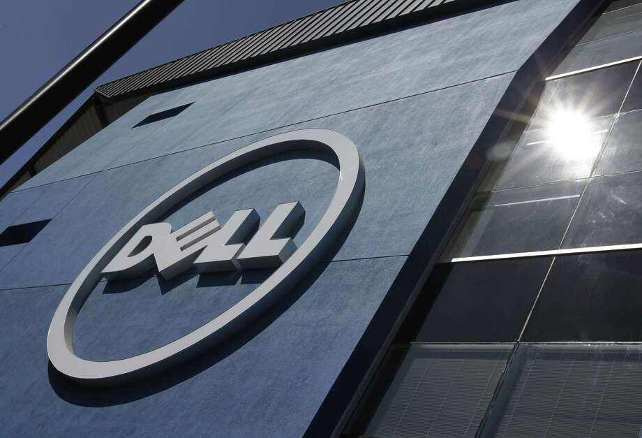 Dell Inc.'s board of directors is projecting another year of lackluster growth in fiscal 2014 as demand for personal computers wanes, underscoring the urgency behind the company's decision to be taken private. Photo: Associated Press File Photo