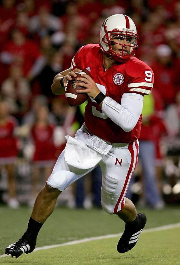 The game uses exact images of real players, including Sam Keller, shown as #9 for the Nebraska Cornhuskers in 2007. Photo: Matthew Stockman, Getty Images