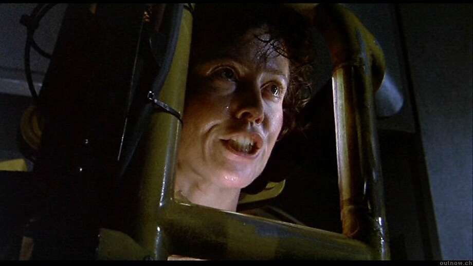 "A facehugger from ""Aliens."" Pictured above, Sigourney Weaver driving a space robot in ""Aliens."" Photo: 20th Century Fox 1986"