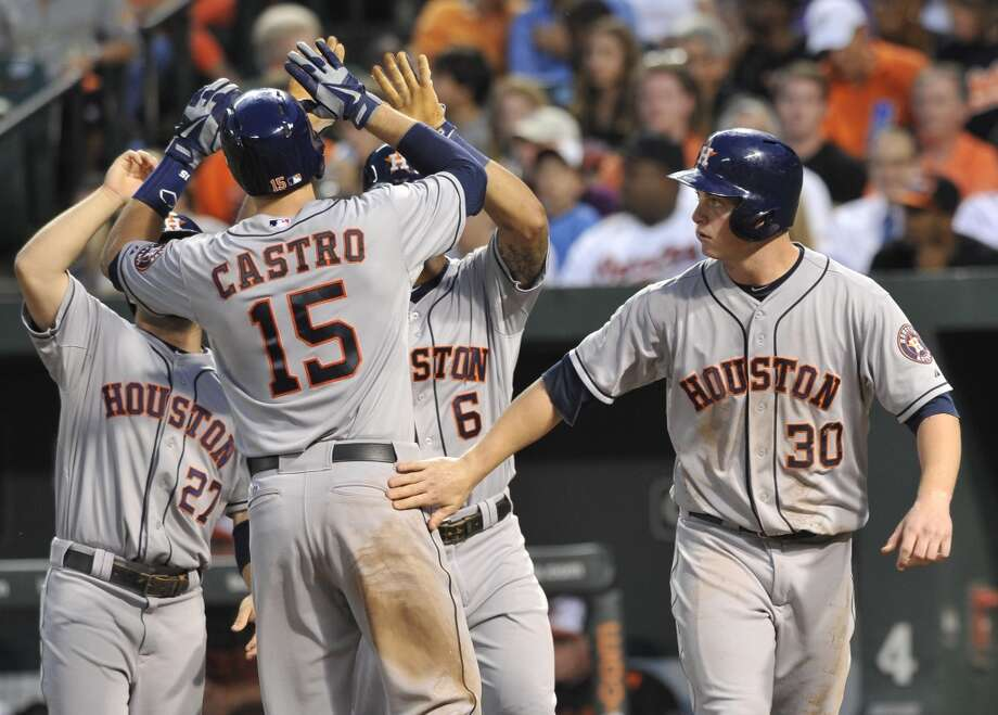 July 31: Astros 11, Orioles 0Astros catcher Jason Castro is congratulated after his grand slam in the fourth inning against the Orioles. Photo: Gail Burton, Associated Press