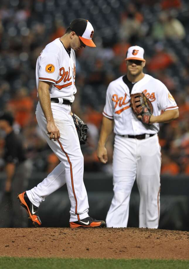 Orioles pitcher Miguel Gonzalez reacts after allowing a grand slam from Astros catcher Jason Castro. Photo: Gail Burton, Associated Press