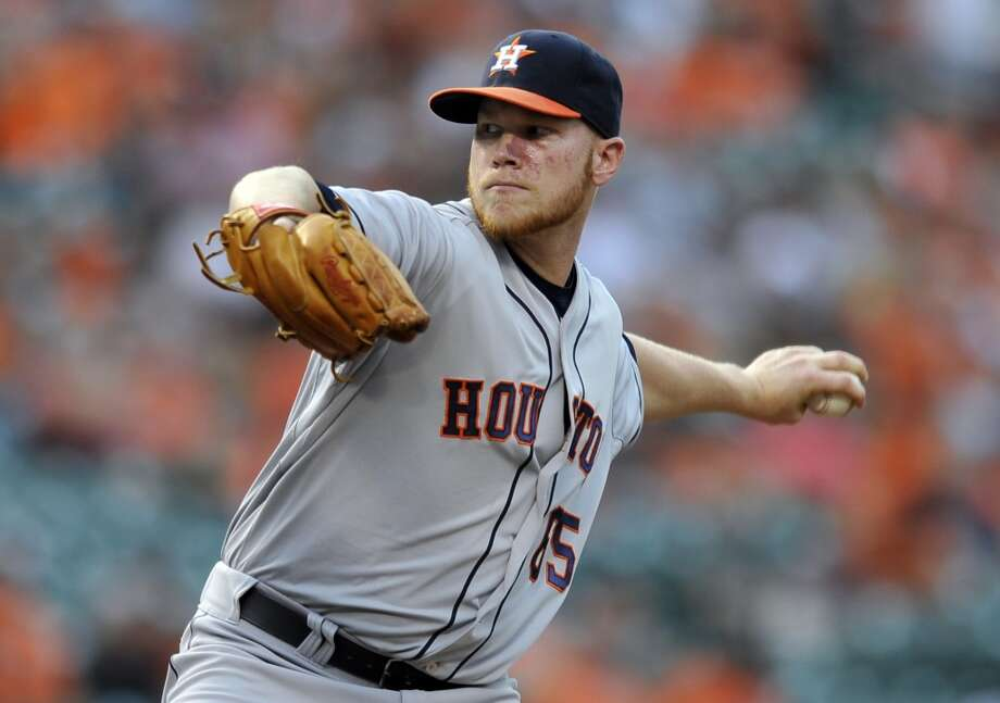 Astros pitcher Brett Oberholtzer makes a throw to the Orioles. Photo: Gail Burton, Associated Press