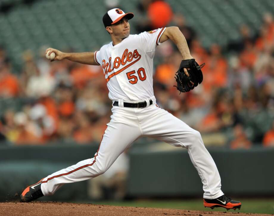 Miguel Gonalez of the Orioles delivers a pitch to the Astros. Photo: Gail Burton, Associated Press