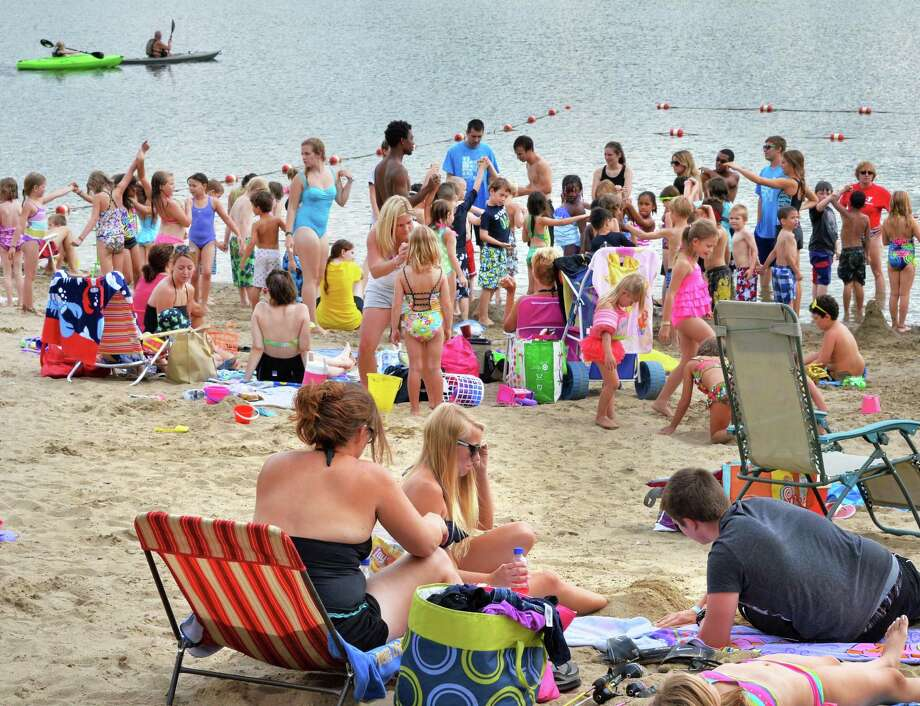 Beach goers at Thompson's Lake State Park in East Berne, NY, Wednesday July 31, 2013.  (John Carl D'Annibale / Times Union) Photo: John Carl D'Annibale / 10023360A