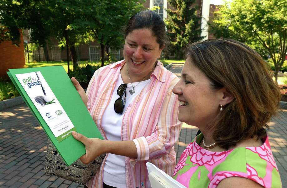 Sam Shipherd of Unity House, left, and Molly Nicol, Director of Development, Catholic Charities of the Albany Diocese, discuss Golf 4 Good golf tourney July 16, 2013, in Troy, N.Y.  The tournament will be held August 12 at the Country Club of Troy. ( Skip Dickstein/Times Union ) Photo: Skip Dickstein / 00023158A