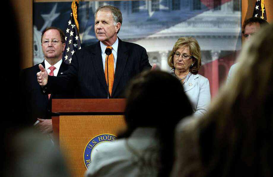 WASHINGTON, DC - JUNE 12:  Rep. Ted Poe (R-TX) speaks during a press conference with Rep. Bill Flores (R-TX) (L) and Rep. Diane Black (R-TN) held by the House Immigration Reform Caucus at the U.S. Capitol June 12, 2013 in Washington, DC. The group held the press conference to announce the introduction of the SMART Border Act of 2013, an immigration reform bill.  (Photo by Win McNamee/Getty Images) Photo: Win McNamee / 2013 Getty Images