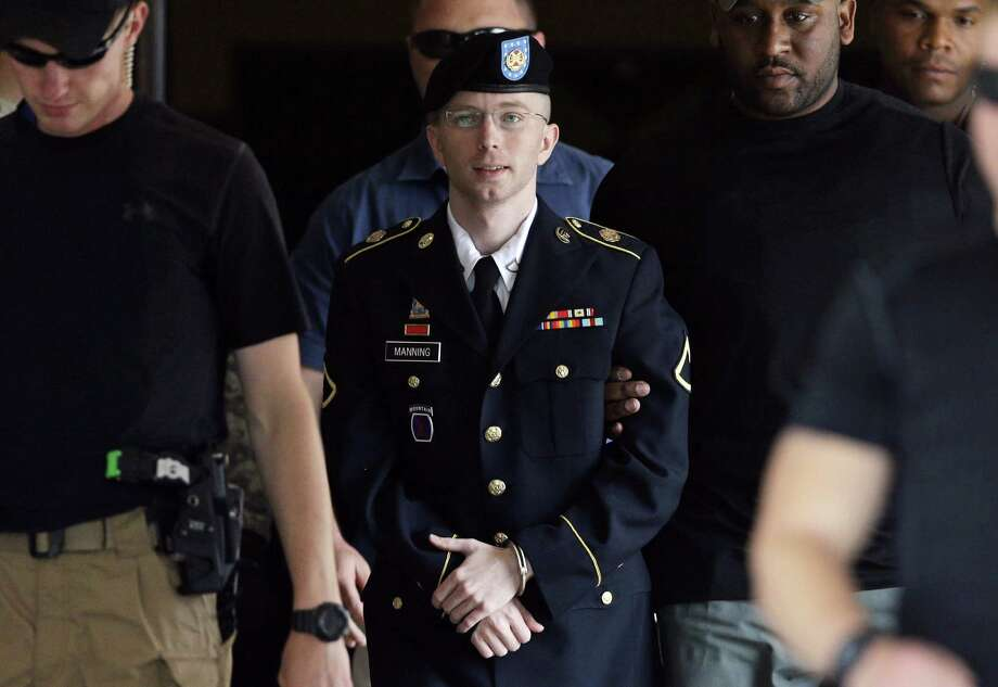 Army Pfc. Bradley Manning is escorted from the courthouse Tuesday in Fort Meade, Md. after being convicted of 20 charges. Photo: Patrick Semansky / Associated Press