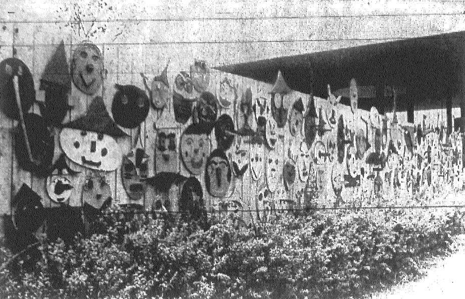 This is the decorated front fence of the Children's Garden at Project Y at HemisFair in July 1968. The faces were made by elementary school children. Photo: San Antonio Light File Photo