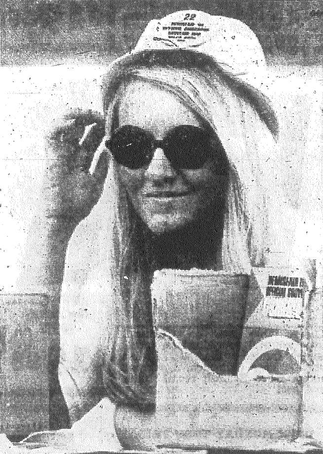 Guidebooks, anyone? This blonde greets hundreds every day at HemisFair, selling handy booklets that tell of all the colorful attractions. Photo taken in August 1968. Photo: San Antonio Light File Photo