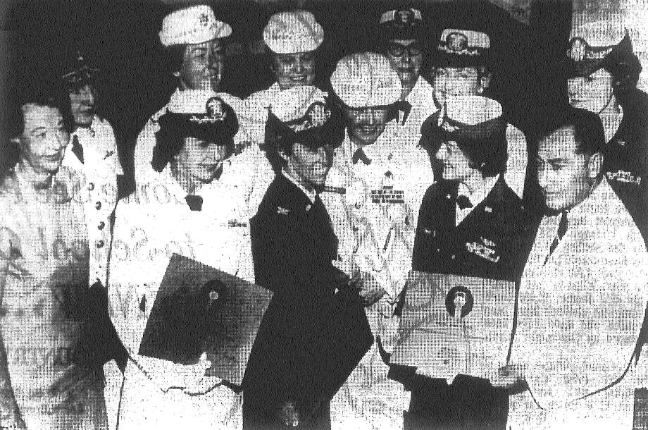 Mrs. Winfield S. Hamlin (left), president of the Women's Pavilion at HemisFair, and fair official Bill Sinkin are with directors of various women's components of the Armed Forces (from left): Capt. Veronica Bulshefski, Col. Jeanne M. Holm, Col. Elizabeth P. Hoisington, Capt. Rita Lenihan, Col. Ethel R. Kovack and Col. Frances G. Ballentine; and Col. Barbar J. Bishop (rear, from left), Col. Mary L. Hamrick, Col. Annamae M. Hays and Capt. Ruth Moeller. They were presented citations. Photo taken in August 1968. Photo: San Antonio Light File Photo