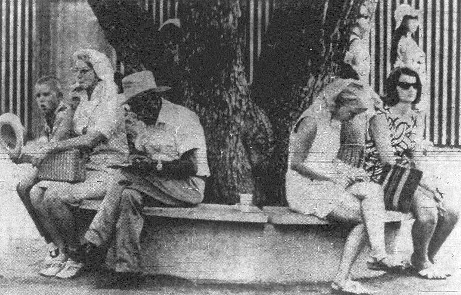 Abundance of benches at HemisFair provides a cooling rest stop while fairgoers map out their next moves in August 1968. In many cases, they're looking for the shortest route from air conditioned pavilion to air conditioned pavilion. Photo: San Antonio Express File Photo