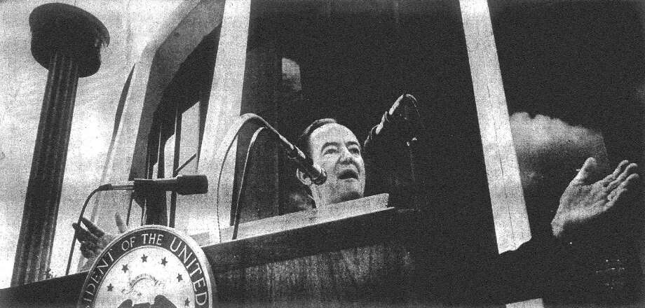 With the Tower of the Americas and the U.S. Confluence Theater in the background, Vice President and presidential hopeful Hubert H. Humphrey delivers his address at HemisFair. Published in the San Antonio Light Aug. 11, 1968. Photo: File Photo