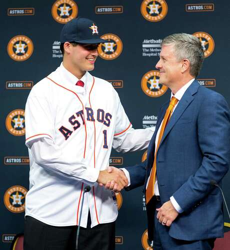 Houston Astros first round draft choice Mark Appel shakes hands with general manager Jeff Luhnow as he is introduced to the media before the Houston Astros game against the Milwaukee Brewers at Minute Maid Park on Wednesday, June 19, 2013, in Houston. ( Smiley N. Pool / Houston Chronicle ) Photo: Smiley N. Pool / © 2013  Smiley N. Pool