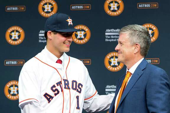 Houston Astros first round draft choice Mark Appel shakes hands with general manager Jeff Luhnow as he is introduced to the media before the Houston Astros game against the Milwaukee Brewers at Minute Maid Park on Wednesday, June 19, 2013, in Houston. ( Smiley N. Pool / Houston Chronicle )