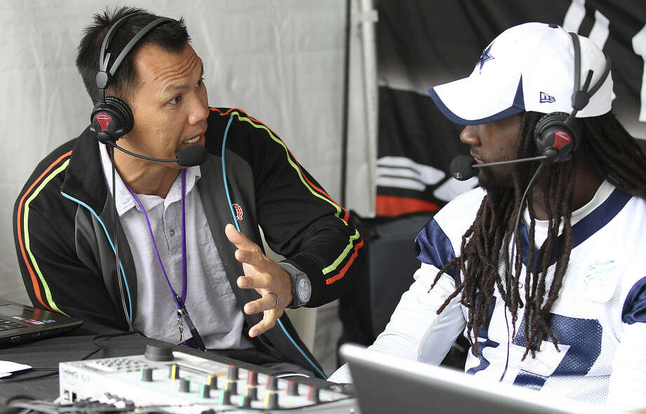 Former Dallas linebacker Dat Nguyen (left) interviews wide receiver Dwayne Harris at training camp in Oxnard, Calif. Nguyen can be heard talking about the Cowboys this season on KZDC-AM 1250 in San Antonio. Photo: Kin Man Hui / San Antonio Express-News