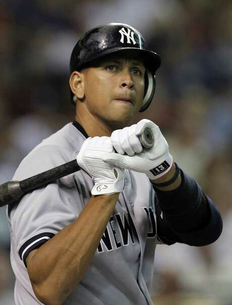 Alex Rodriguez could be banned for good after being linked to a Florida clinic accused of distributing PEDs. Photo: Ross D. Franklin / Associated Press