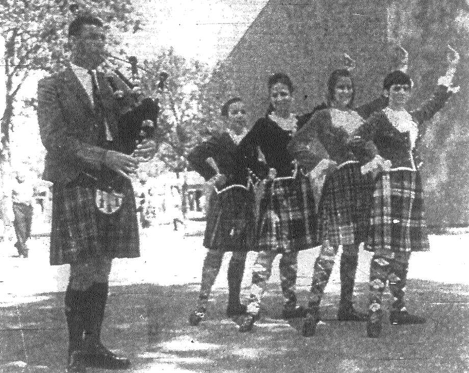 R.C. Forbes pipes a tune for Scottish dancers Karen Metcalf (from left), Nancy Forbes, Darla Griser and Dena Chambliss at the opening of HemisFair's three-day Scottish Festival. All are from Dallas. Published in the San Antonio News Aug. 22, 1968. Photo: File Photo