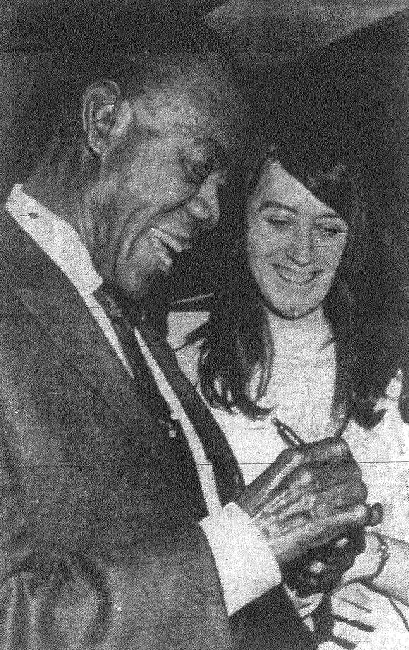 Louis Armstrong signs an autograph for Kathy Kennedy upon his arrival at San Antonio International Airport. Satchmo is in town to perform at HemisFair. Published in the San Antonio Express Aug. 19, 1968. Photo: File Photo